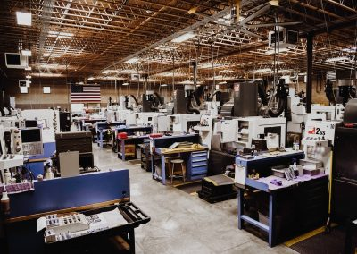 inside of Top Precision's facility, a CNC machine shop, featuring lathes and mills