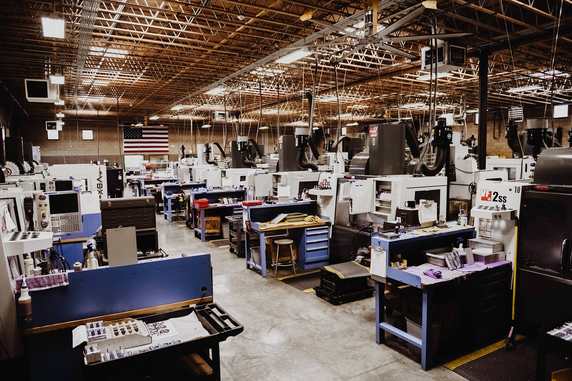inside of Top Precision's facility, a machine shop, featuring lathes and mills